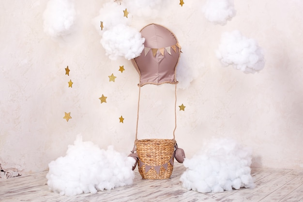 Childhood dreams. stylish vintage children's room with aerostat, balloons and textile clouds. children's location for a photoshoot: aerostat, balloon and clouds. interior children's room for games.