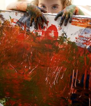 Children artist hands painting multi colors