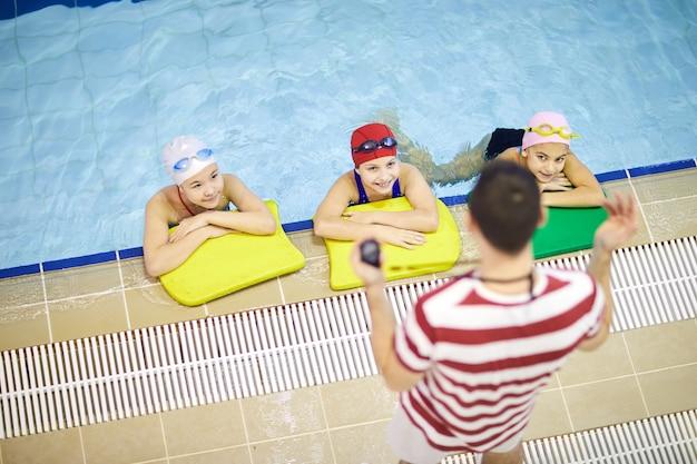 Children attending swimming lesson