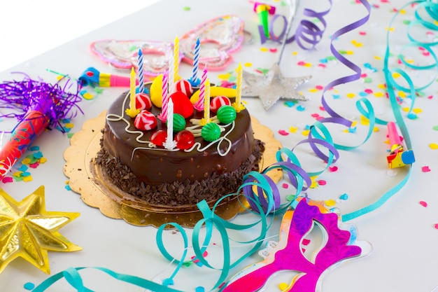 Children birthday party with chocolate cake