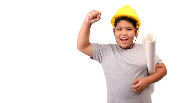 Children boy engineer isolated on white background.