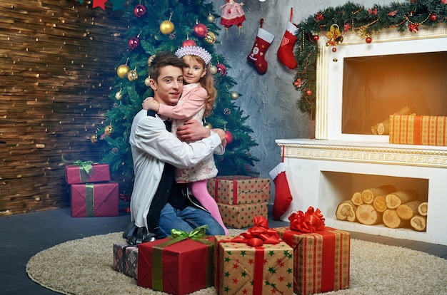 Children, boy and girl, fireplace christmas and new year