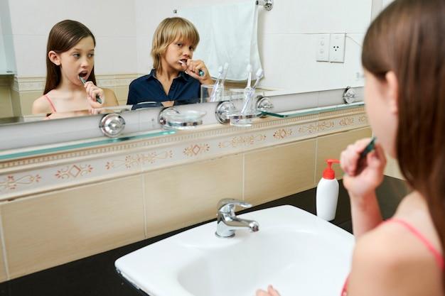 Children brushing teeth