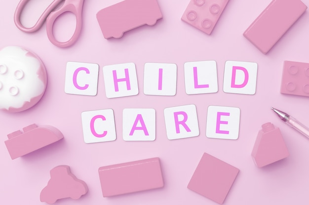 Children care concept text on pink toy