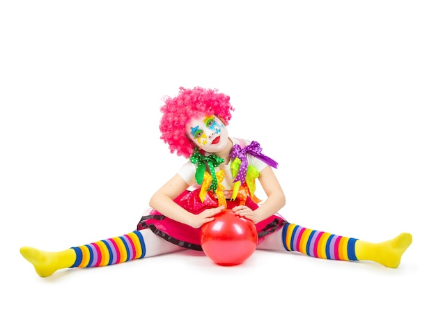Children in colorful clown outfits isolated on a white background