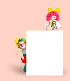 Children in colorful clown outfits