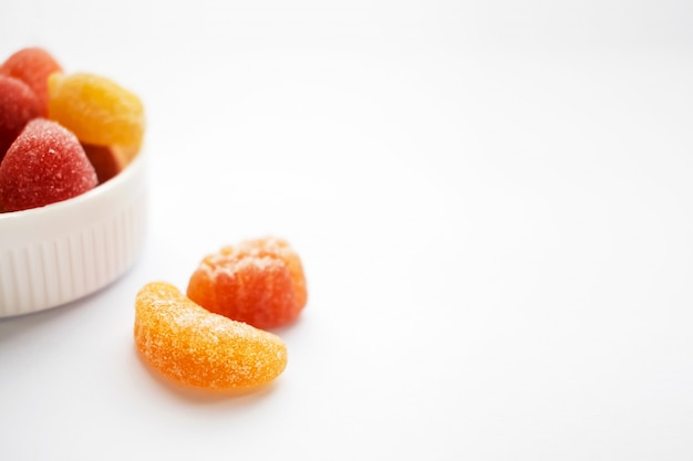 Children colorful gummy vitamins on white background. multivitamin soft jelly candies