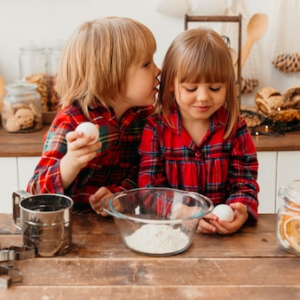Children cooking together at home