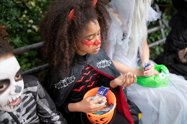 Children in costumes eating their candies