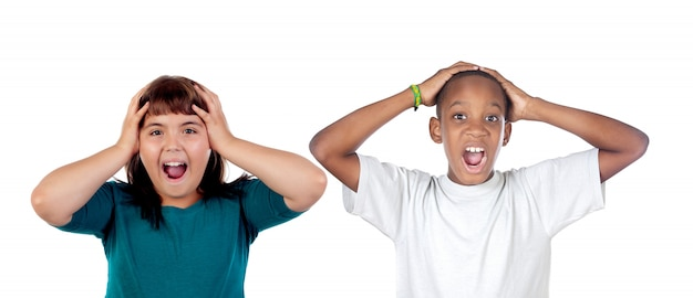 Children covering the ears and shocked by a loud sound