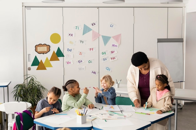 Children drawing together in the classroom