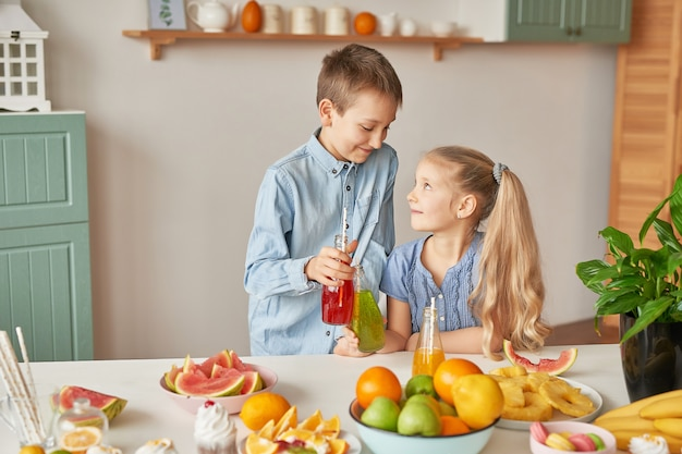 Children drinking juices at the kitchen