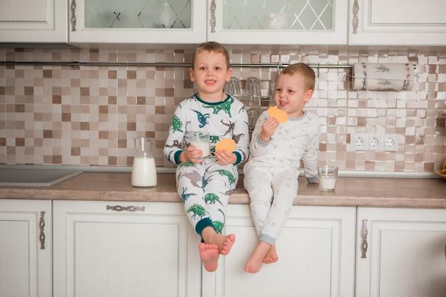 Children eat breakfast in pajamas