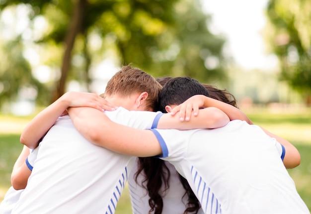 Children encouraging each other