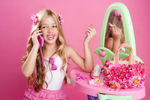 Children fashion doll blond girl talking mobile phone