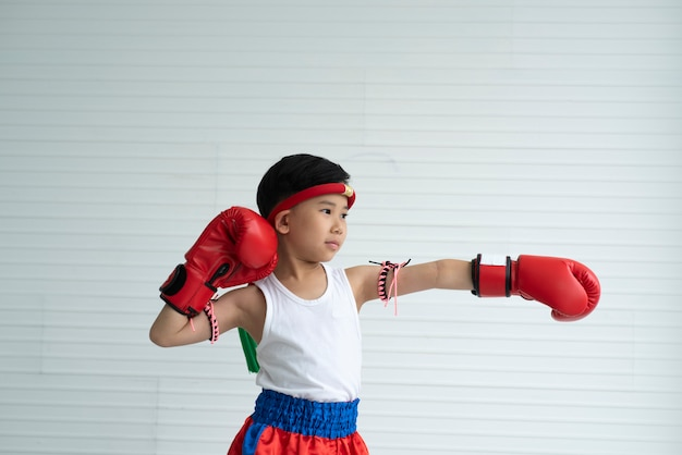 Children in fighting concept, boxing boy