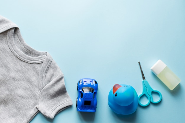 Children flat lay with clothes blue top view