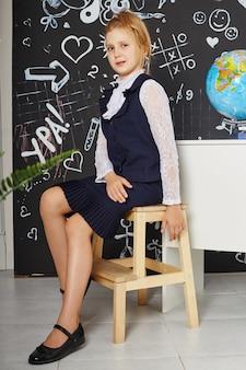 Children girl student study at school first of september