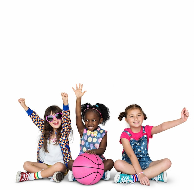 Children girlfriends smiling happiness basketball togetherness studio portrait