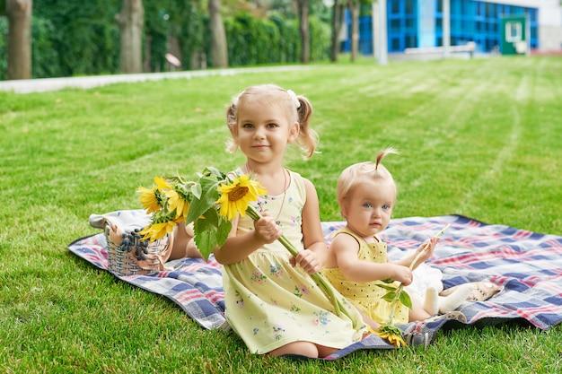 Children girls in summer park