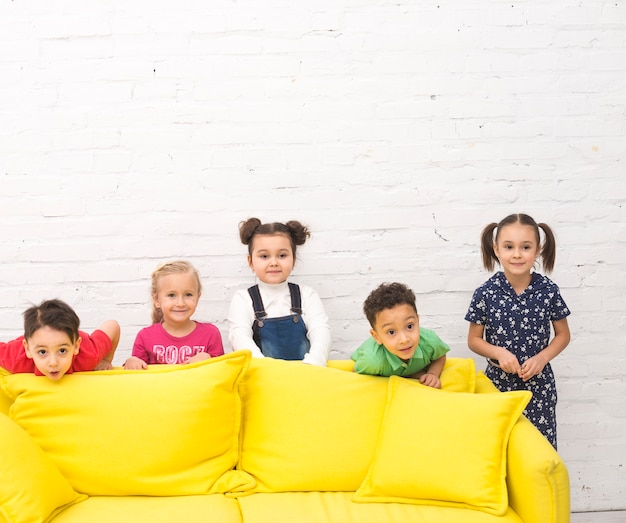 Children group playing in a sofa