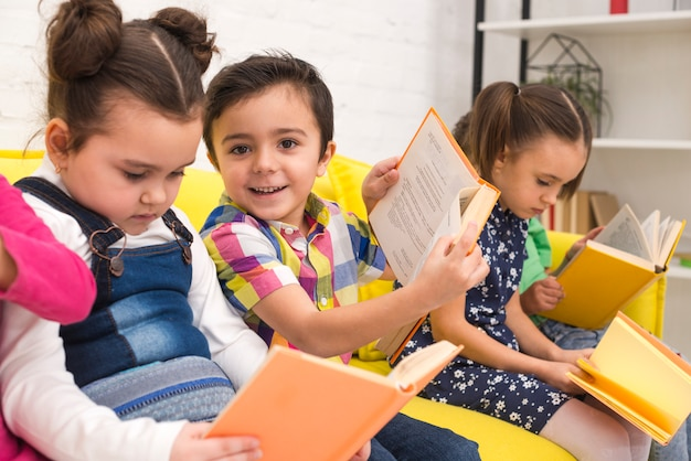 Children group reading books