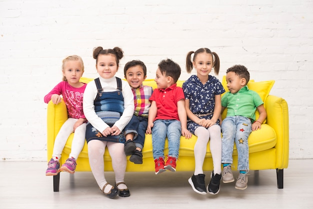 Children group in a sofa