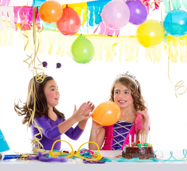Children happy birthday party girls with balloons