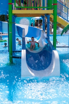 Children have a good time at the water park and ride on water slides
