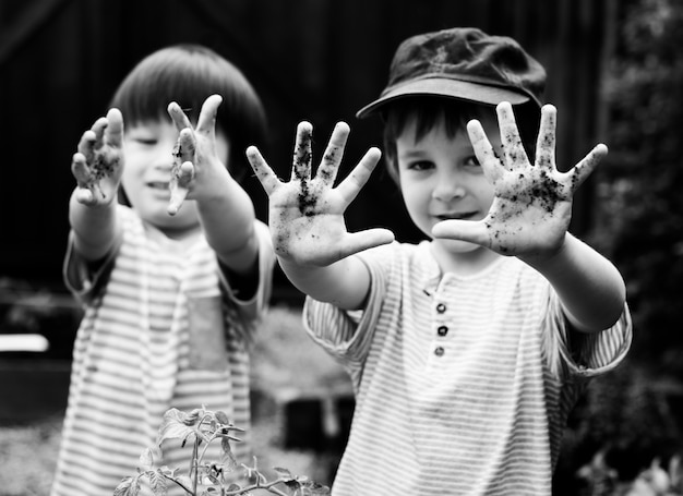 Children having fun with dirt on their hands