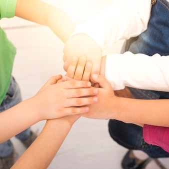 Children holding hand in group