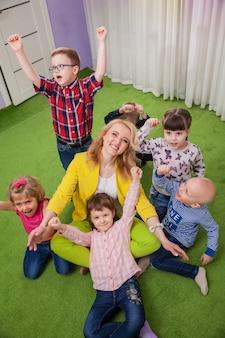 Children hugging teacher