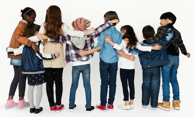 Children hugging togetherness studio concept