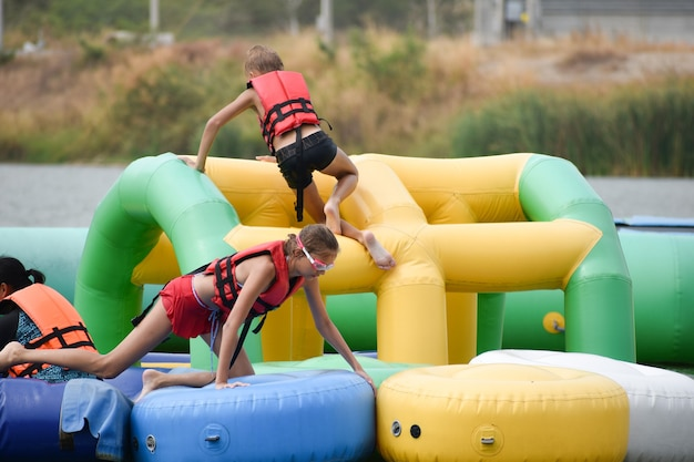 Children on inflatable water attractions.