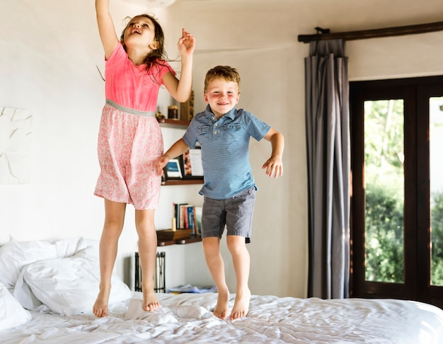 Children jumping on the bed