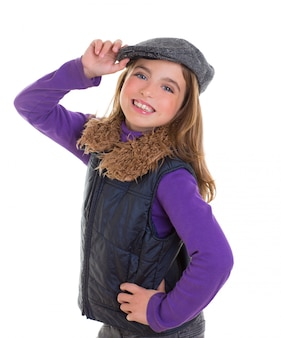 Children kid winter girl with cap coat and fur smiling