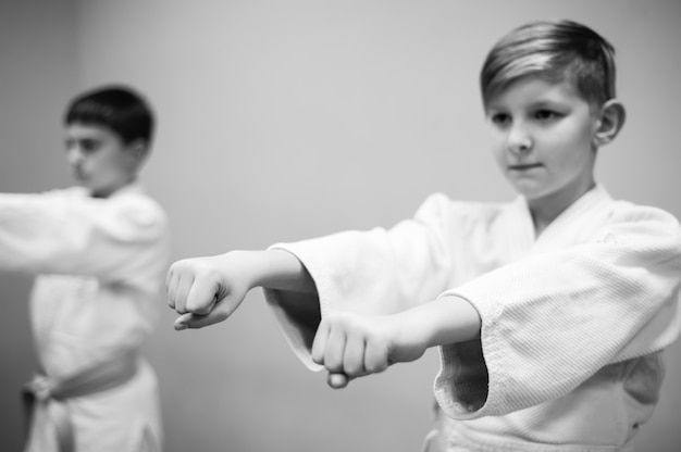 Children in kimono begin training on aikido