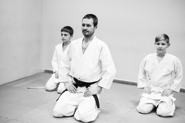 Children in kimono begin training on aikido.