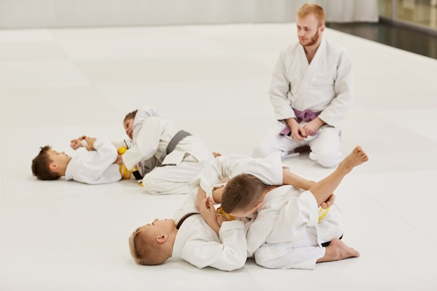 Children learning to fight during the lesson