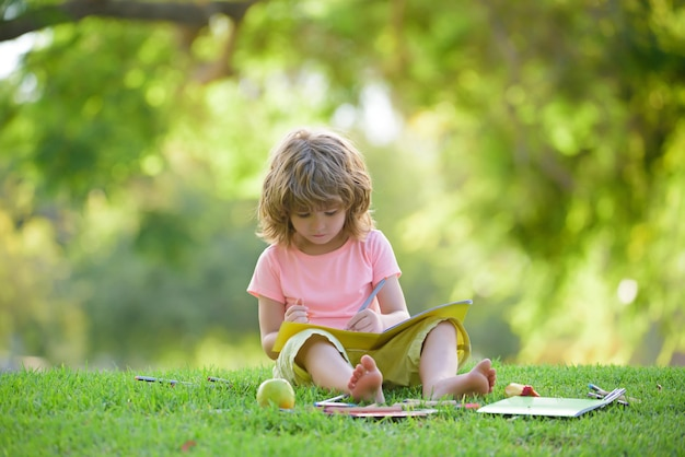 Children learning in park. cute pupil in elementary school.