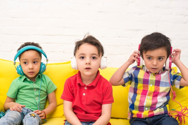 Children listening to music with headphones