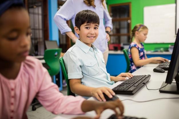 Children looking their computer