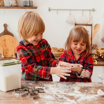 Children making christmas cookies