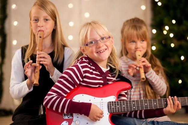 Children making music for christmas