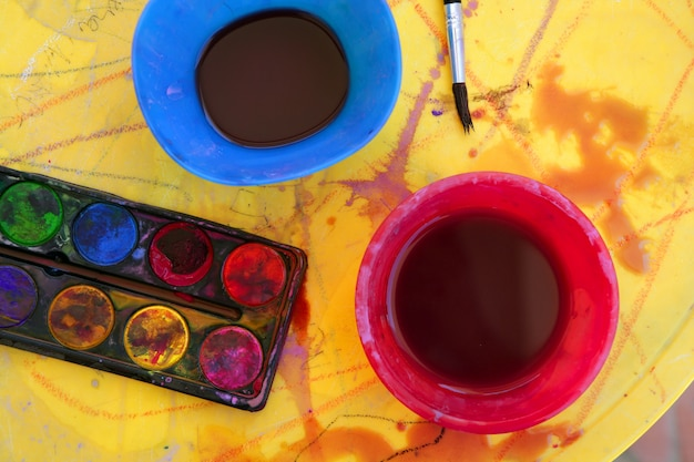 Children messy dirty student watercolor table