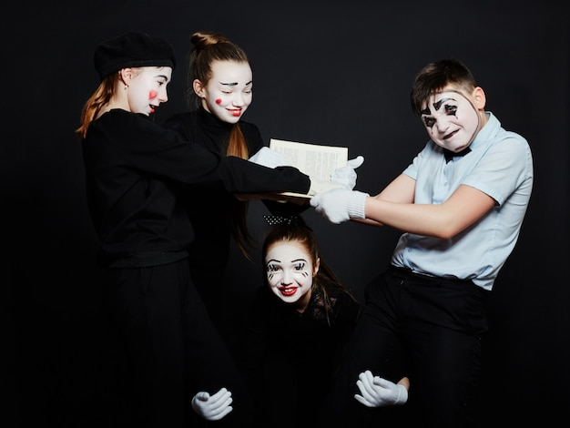 Children mime group photo, pantomime various emotions on children's face.
