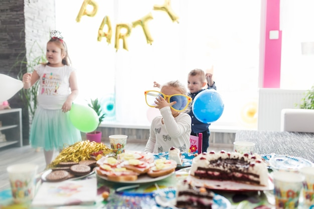 Children near table on birthday party