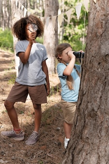 Children participating in a treasure hunt in a forest