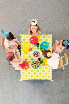 Children party at colored table