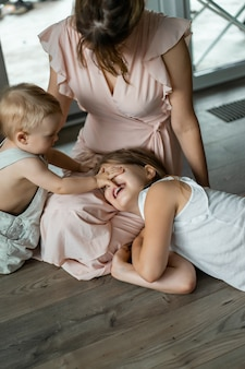 Children play in the house, homely atmosphere. siblings spend time together.